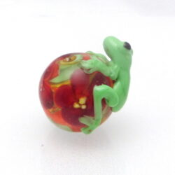 Green frog on red flower bead
