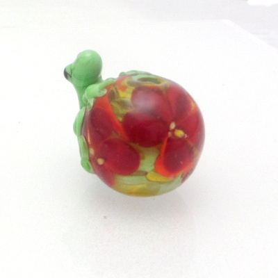 red flower bead with green frog