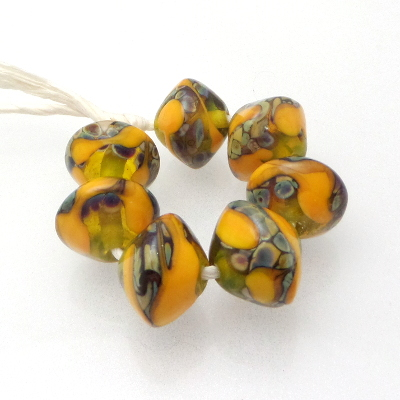 Sinflower Drozzle on Ralu Yellow Lampwork Beads