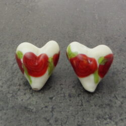 Glass heart red rosette pair